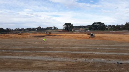 Premier oval preparation placement of turf growing medium, cricket wicket and drainage also visible