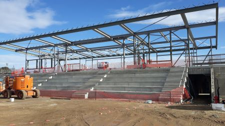 Building B (soccer) progress incl ground floor blockwork walls and teired spectator seating preparation and first floor structural steel