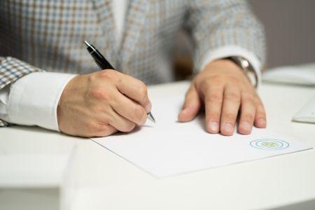 JP Service - Man Signing Document