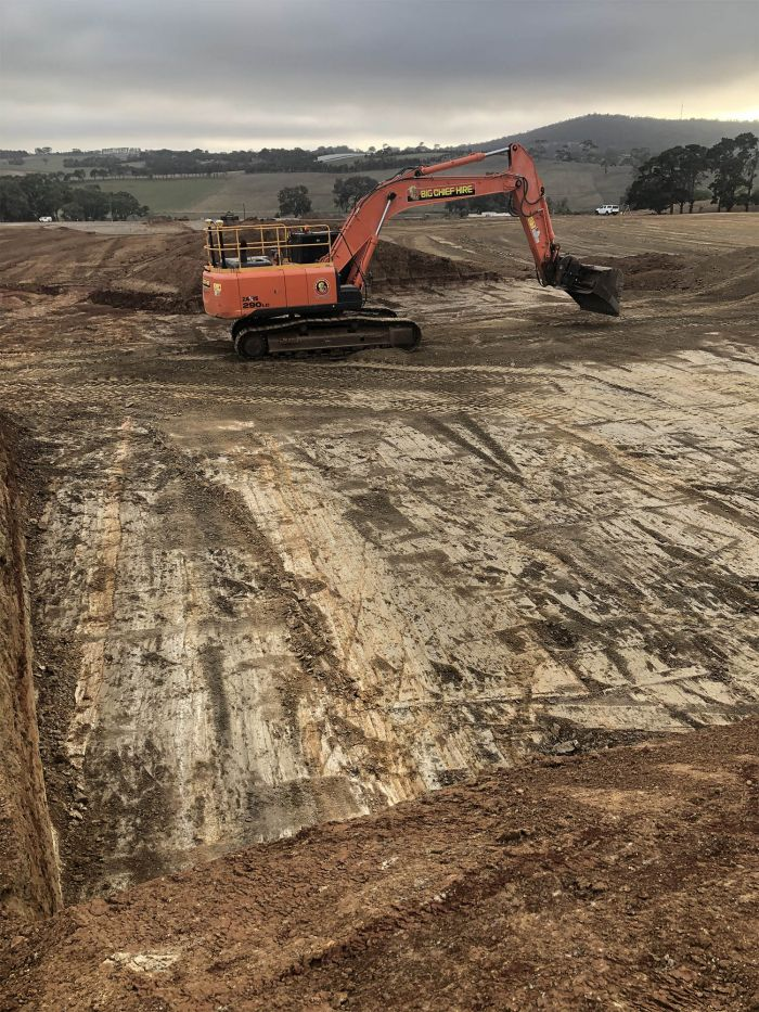 RSH 28 tonne excavator at work on the Aussie rules-cricket building March 2020