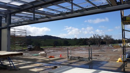 Building A Soccer overlooking pitch toward summit August 2020